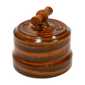 Выключатель одинарный поворотный керамика декор палисандр